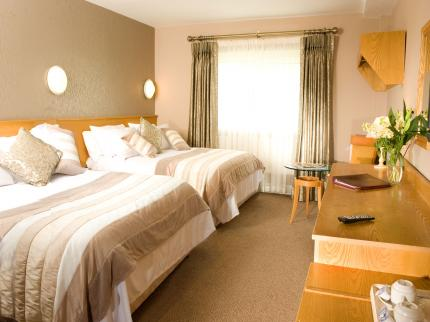 Commons Inn Hotel - Laterooms